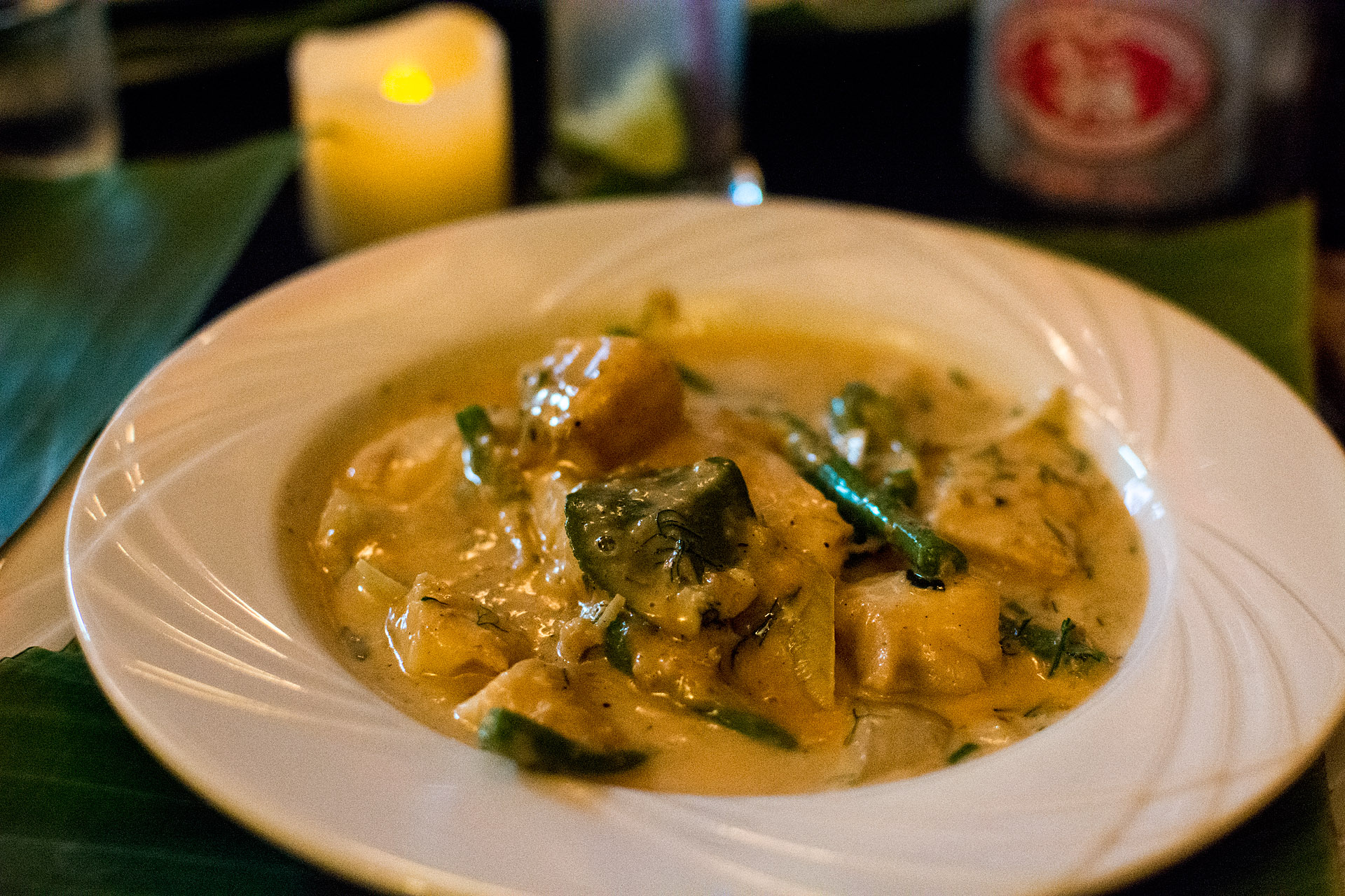 Poached catfish w/ coconut milk, basil & chili (Cafe Toui)